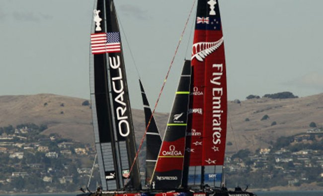 Emirates Team New Zealand (R) and Oracle Team USA sail during Race 16 of the 34th America\'s Cup