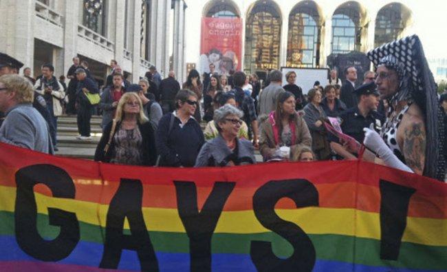 Anti-Putin protestors demonstrate in front of the Metropolitan Opera at Lincoln Center