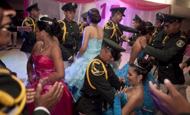 Nicaraguan girls suffering from cancer dance with army cadets during a \'quinceanera\' party