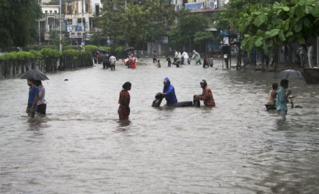 A view of a flooded locality after heavy rains in Surat on Tuesday. PTI Photo