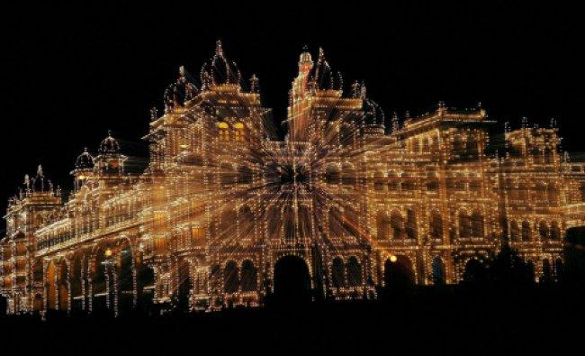 Illumination of lighting on Mysore palace ahead of the Dussehra festival in Mysore on Tuesday. PTI