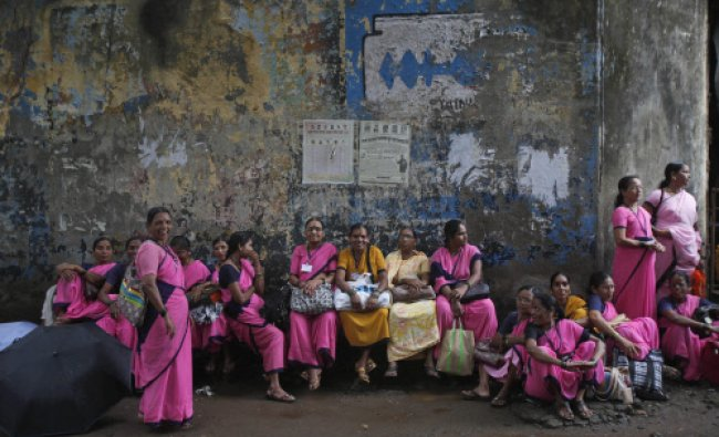 Workers of Anganwadi, or government-sponsored child-care and mother-care, sit during a protest in...