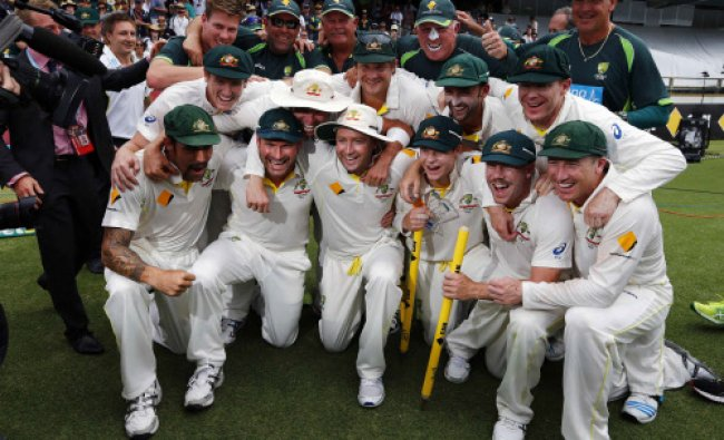 Australia\'s players pose for pictures after winning the Ashes test cricket series against England...