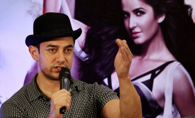 Bollywood actor Aamir Khan addressing a press conference to promote his film \'Dhoom 3\' in...
