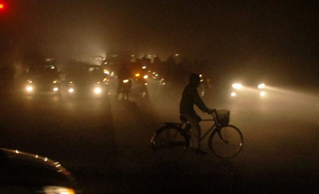 People move in heavy fog in Patiala on Tuesday. PTI Photo