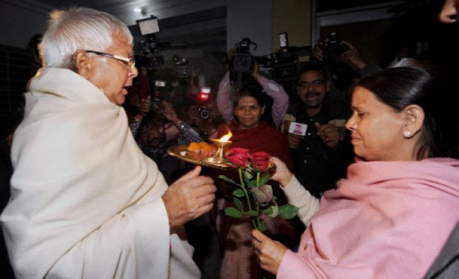 RJD chief Lalu Prasad Yadav being welcomed by his wife and former Bihar chief minister Rabri Devi...