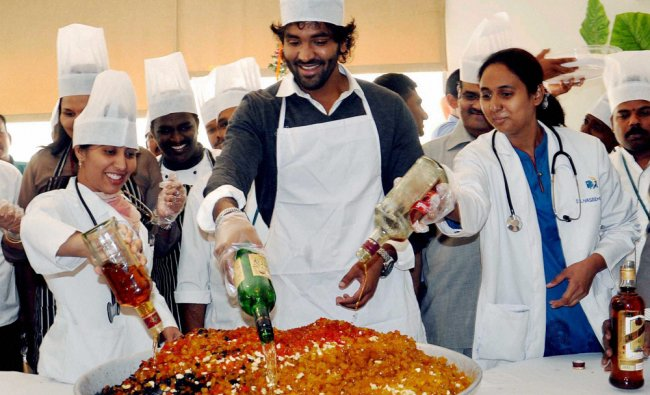 Actor Manchu Vishnu takes part in the cake-mixing ceremony ahead of Christmas in Hyderabad ...