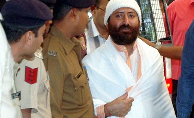 Narayan Sai, accused in a rape case, being produced in court in Surat ...