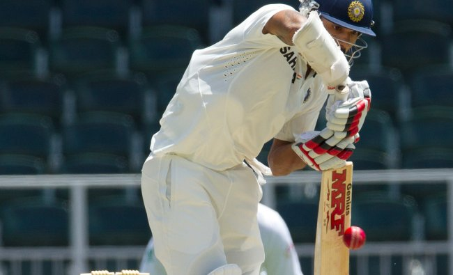 Shikhar Dhawan, plays a shot during the first day of their cricket test match against South Africa .