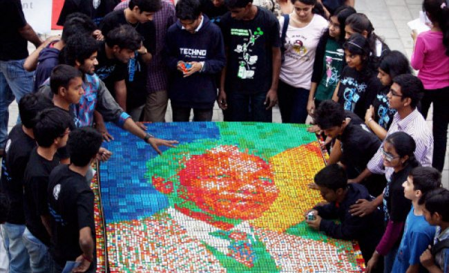 College students create a portrait of late Nelson Mandela out of Rubik\'s cube in Mumbai on...