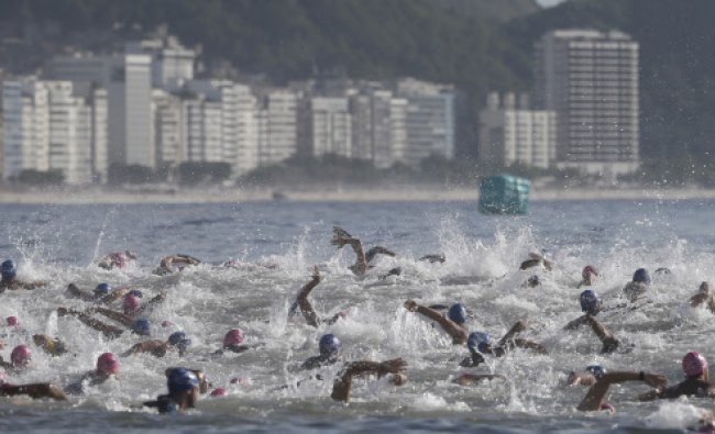 In this Dec. 14, 2013 photo, swimmers participate in the two-day \'King and Queen of the Sea\'...