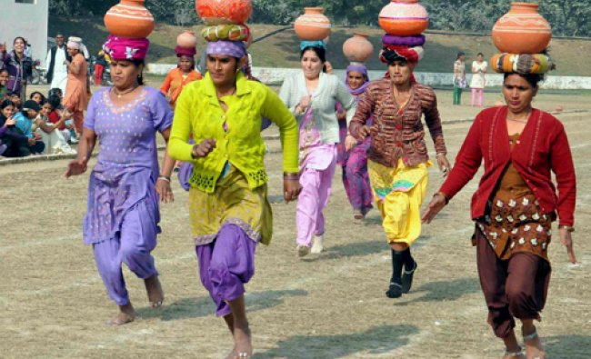 Women take part in earthen pitcher race at an sports event organised for women in Faridabad on...