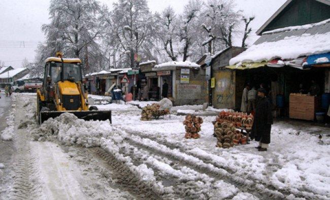 A snow cutter clears the Srinagar-Jammu National Highway after heavy snowfall at Anantnag...