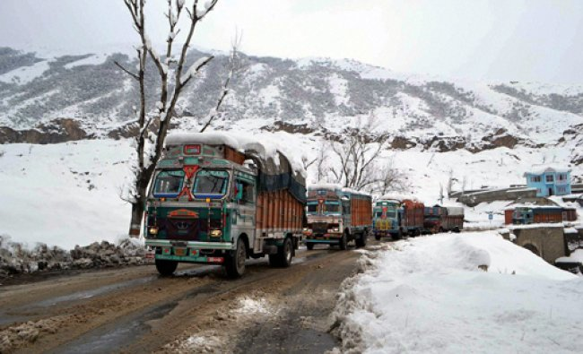 Trucks move towards from Srinagar to Jammu afte traffic reopened one-way after a three-day long...