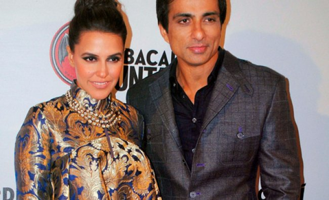 Bollywood actors Neha Dhupia and Sonu Sood participate in an event at Kingdom of Dreams in...