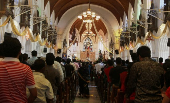 Christians offering prayer on the occasion of Christmas in Santhome Church in Chennai on Wednesday.
