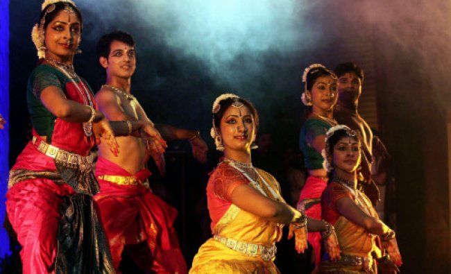 Artists perform during the inauguration of the Bangalore International Film Festival in Bengaluru...