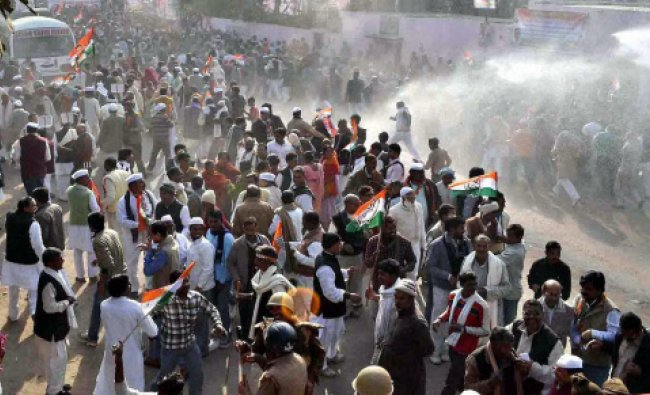 Police use water cannon on protesting Congress workers in Varanasi on Thursday.
