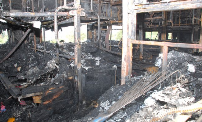 Charred interiors of AC coach of Bangalore-Nanded express caught fire near Kothacheruvu railway...