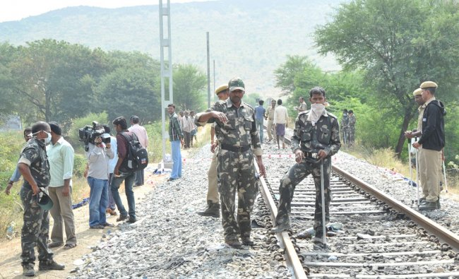 Security personnel cordonning off pepople from the tracks where the Bangalore-Nanded express...