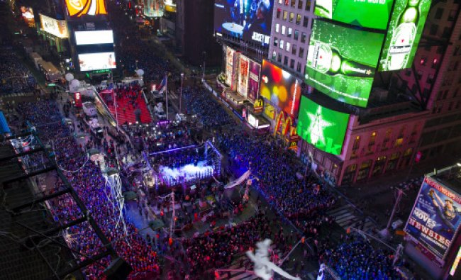 Seen from the Marriott Marquis, people crowd into Times Square for New Year\'s Eve celebrations...