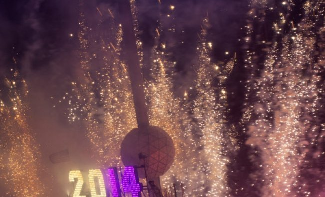 Fireworks explode past the Times Square Ball after it dropped to signal the start of the new year...