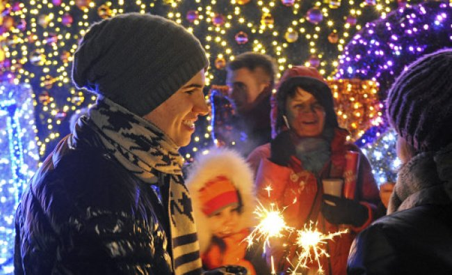 People celebrate the New Year\'s Eve in the Old Town in Warsaw, Poland, Wednesday, Jan. 1, 2014.