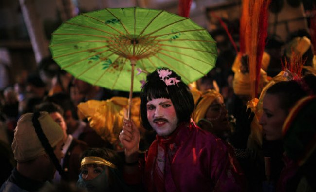 A reveller dressed up as a geisha takes part in New Year\'s celebrations in Coin...