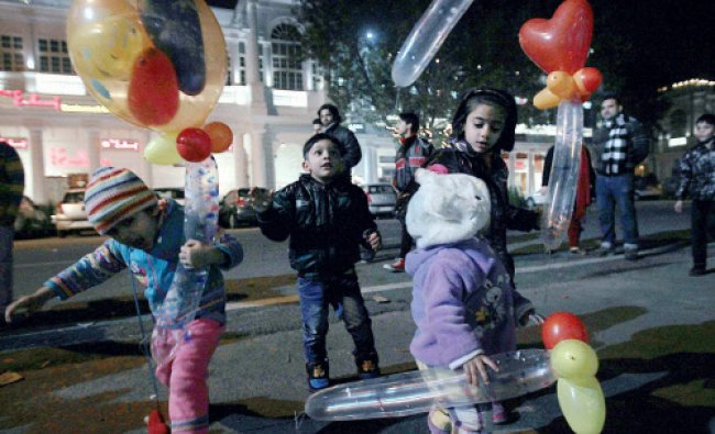Children celebrating on the eve of new year 2014 at Cannaught Palce in New Delhi on Tuesday night...