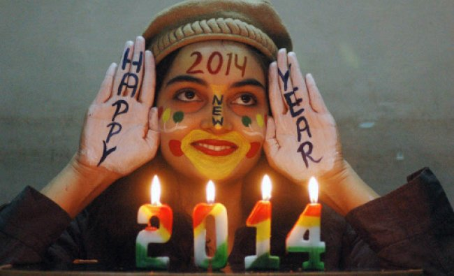 A young girl painted her face to celebrate the New Year 2014 in Mirzapur on Wednesday.
