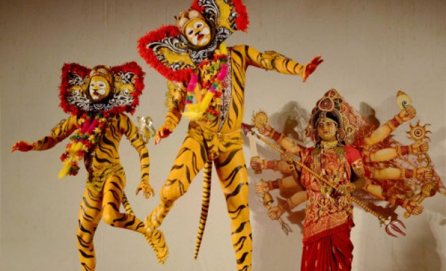 Artists from Orissa performing a Mask dance based on the theme of \'Save Nature Save Tigers\' during..