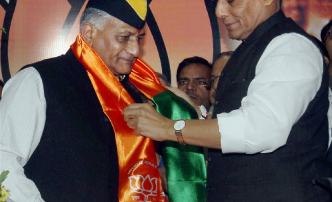 Former Army Chief General V.K. Singh is greeted by BJP President...