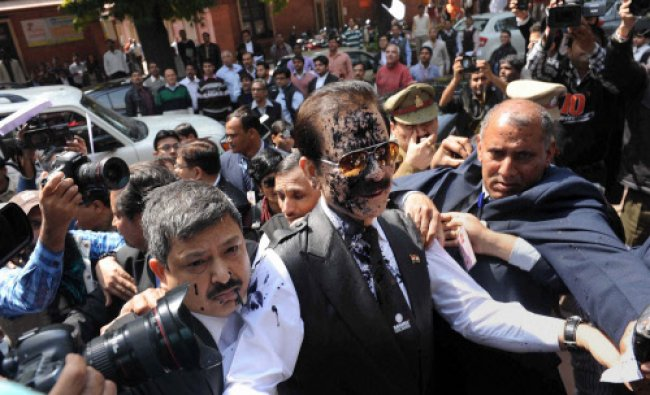 Chairman of Sahara India Pariwar Subrata Roy, with face smeared with ink thrown by a lawyer ...