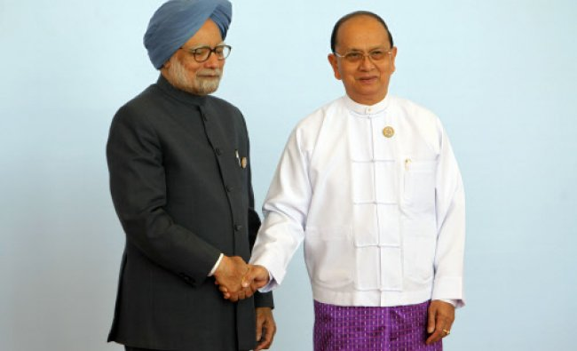 Myanmar President Thein Sein, right, welcomes Prime Minister Manmohan Singh during the opening ...