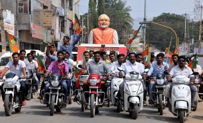 BJP activists take part in a bike rally at Chikmagalur in Karnataka on Tuesday. PTI Photo