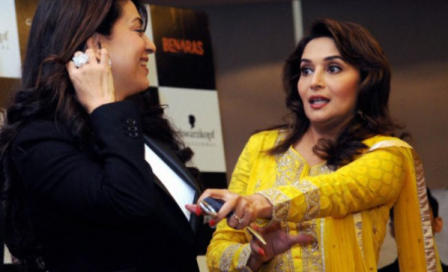 Actresses Madhuri Dixit and Juhi Chawla at a promotional event for their film...