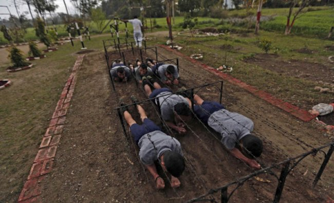 Trainees take part in an exercise during a training session at the training academy...