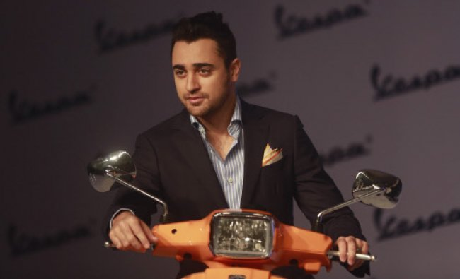 Imran Khan poses for photographs during the launch of \'Vespa S scooters in Mumbai...