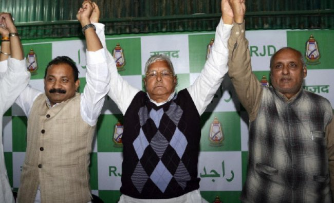 RJD chief Lalu Prasad along with Bihar Congress President Ashok Choudhary and NCP spokesman..