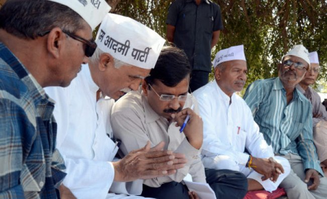 Aam Aadmi party chief and former Delhis chief minister Arvind Kejriwal talks with...