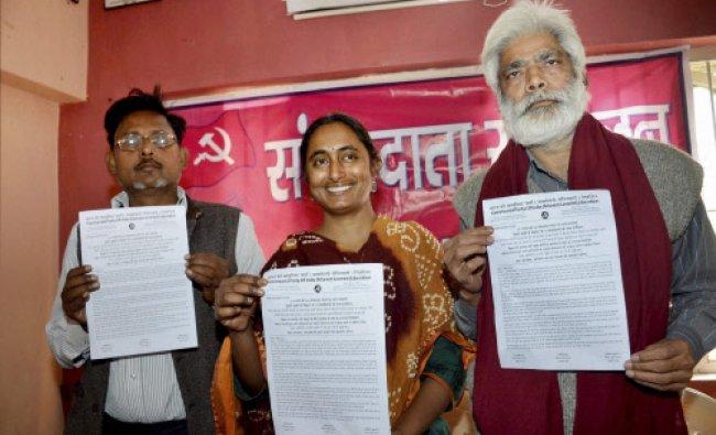CPI-ML Polit Bureau members Ramji Rai, Kavita Krishnan and Dhirendra releasing Lok Sabha...
