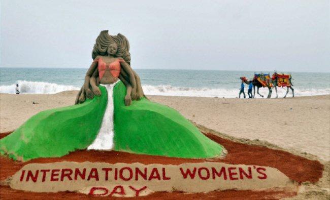 Sand artist Manas Sahoo creates a sand sculpture ahead of International Women\'s Day at Puri...
