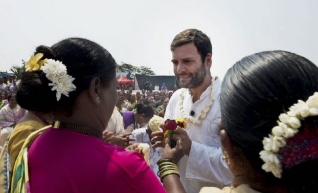 Congress Vice President Rahul Gandhi is greeted by women during his interaction...
