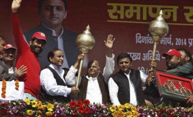 Samajwadi Party chief Mulayam Singh Yadav, center left and Uttar Pradesh state chief minister...