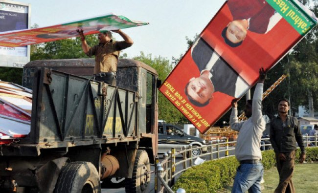 Municipal workers removing hoardings of political parties after announcement of poll dates...