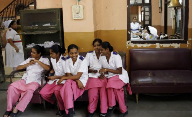 Nurses rest at a government hospital in Mumbai, India, Friday, March 7, 2014, on the eve...