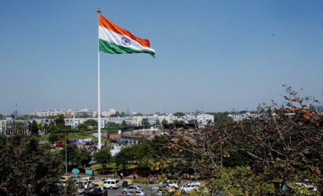 A national flag, measuring 90 feet in length, 60 feet in width and weighing 35 kilograms...