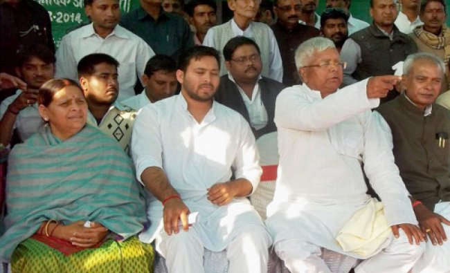 RJD chief Lalu Prasad, his wife Rabri Devi and son Tejaswi during an election meeting...