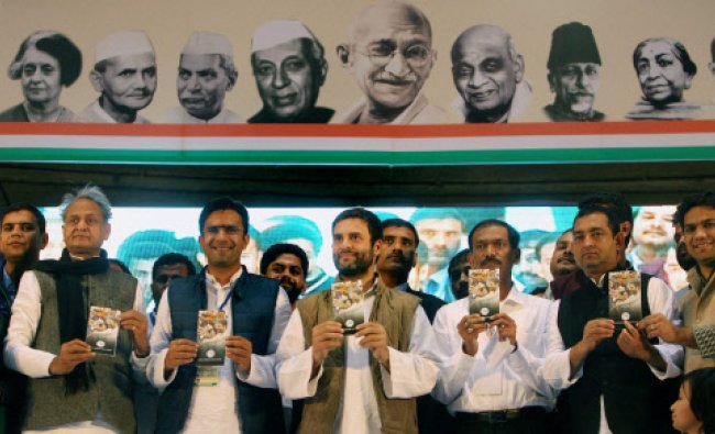 Congress Vice President Rahul Gandhi releases a booklet with student leaders during...