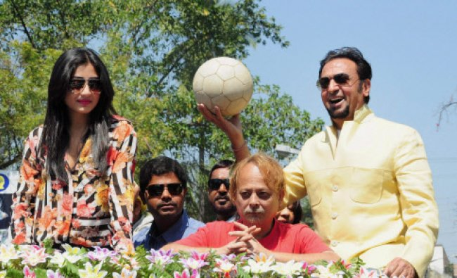 Bollywood actors Gulshan Grover and Rimi Sen during a football tournament in Malda on Saturday.